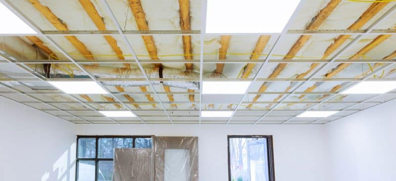 Suspended ceiling structure with insulation showing