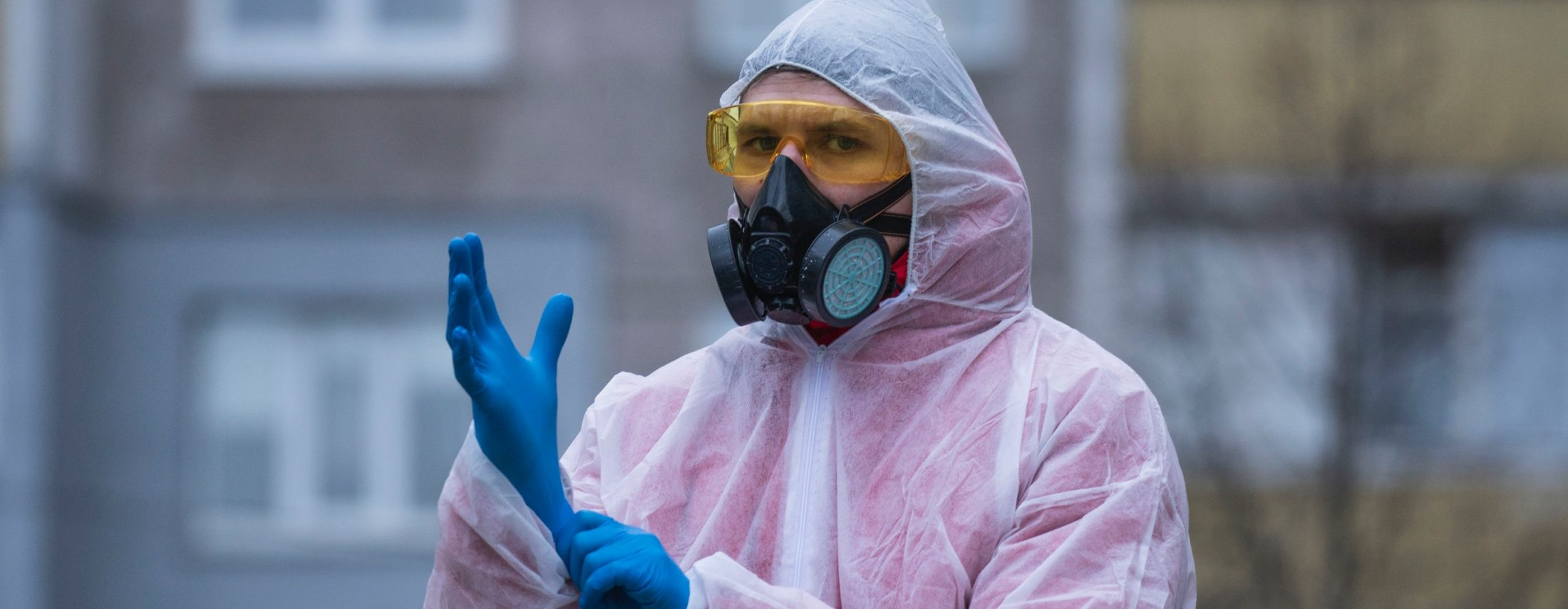 Man in protective chemical suit and respirator